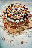 Cake with Custard Cream. Chocolate Topping, Nuts, Tangerines Stock Images