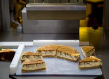 Cake Cutting Machine. For bakery production line Royalty Free Stock Photography