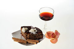 Cake and cwine. A glass of wine, cakes and nuts Royalty Free Stock Image
