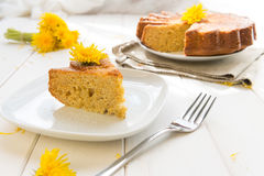 Cake with dandelion's flowers Stock Photos