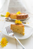Cake with dandelion's flowers Royalty Free Stock Photo