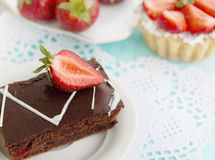 Cake with dark chocolate and strawberries Royalty Free Stock Photography