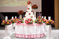 Cake decorate with pink rose, flower and candle for Wedding Ceremony Stock Image
