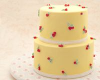 Cake decorated. With fondant surrounded by blur background Royalty Free Stock Image