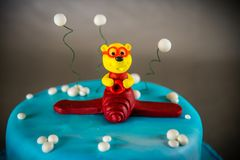 Cake decorated with bear on a plane Royalty Free Stock Images
