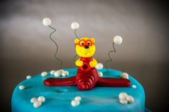 Cake decorated with bear on a plane Royalty Free Stock Photography