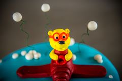 Cake decorated with bear on a plane Stock Image