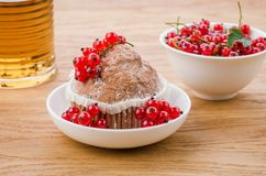 Cake is decorated with berries and red currant in a white plate/cake is decorated with berries and red currant in a white plate. Cake is decorated with berries stock photo