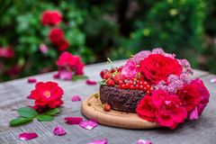 Cake decorated by berries and roses Royalty Free Stock Images