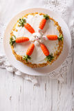 Cake decorated with bunny and carrot. vertical top view Royalty Free Stock Photos