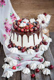 Cake decorated with chocolate, meringues and fresh berries Stock Images