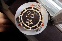 Cake decorated chocolate with number twenty three on plate on celebrate 23 february.  Stock Photos