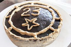 Cake decorated chocolate with number twenty three on plate on celebrate 23 february.  Royalty Free Stock Image