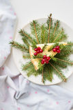 Cake decorated Christmas tree branches and berries  Royalty Free Stock Images