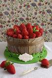 Cake decorated with fondant and fresh strawberries. Small cake decorated with fondant decoration and fresh strawberries stock photography