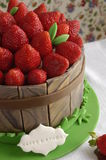 Cake decorated with fondant and fresh strawberries royalty free stock images