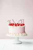 Cake decorated with maraschino cherries Royalty Free Stock Images