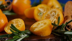 Cake decorated with rosemary, kumquat and gingerbread cookies. Cake decorated kumquat and cinnamon royalty free stock images