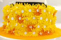 Cake decorated with yellow flowers Royalty Free Stock Photo