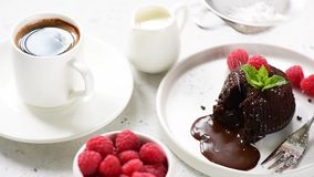 Cake decorationg with powdered sugar. Chocolate lava cake or molten core cake stock footage