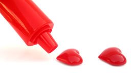 Cake decorator icing syringe is making hearts Stock Image