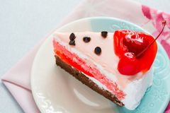 Cake delicious decorated with whipped cream and cherries Royalty Free Stock Photo
