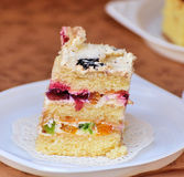 Cake. A delicious piece of cake with fruits royalty free stock photography
