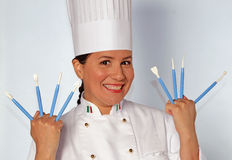 Cake design woman holding cook utensils Stock Images