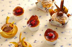 Cake dessert. Creme brulee, Pumpkin Cupcakes and Mont-Blanc cake on the Floral pattern Stock Photography