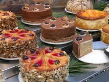 Cake Desserts on Display in Department Store Restaurant and Bake Shop. In Berlin Germany. Nut torte with marzipan hazelnet cheesecake bombe chocolate walnuts stock photos