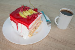 Cake on dish with currant in a relaxing time. Piece cake on white plate with fork Stock Photos