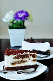 Cake on dish. Tiramisu and Chocolate cream cake stock photos