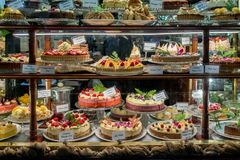 Cake display in a patisserie. Dessert shop bakery stock photos