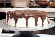Cake drizzled with chocolate. Cake drizzled with melted chocolate Stock Photo