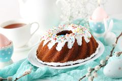 Cake with easter eggs. Bundt cake with sprinkles and easter eggs Stock Photography