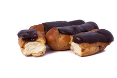 Cake eclair custard is broken in half on white. Delicious Cake eclair custard is broken in half on white royalty free stock images