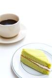 Cake en koffiekop Stock Foto's