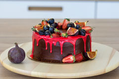Cake with fig fruits, grapes and a strawberry stock images