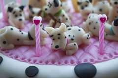 Cake with figures of marzipan Dalmatian puppies Stock Images