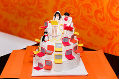 Cake figurines of the bride and groom with a laptop Stock Images