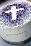 Cake for the first holy communion with cross Stock Images