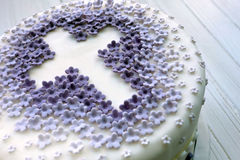 Cake for the first holy communion with cross on white background Stock Images