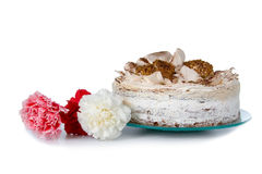 Cake and flowers Stock Photos