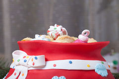 Cake in the form of a bag with gifts from Santa Claus. Christmas Royalty Free Stock Image