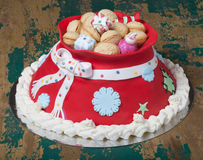 Cake in the form of a bag with gifts from Santa Claus. Christmas Royalty Free Stock Images