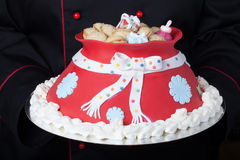 Cake in the form of a bag with gifts from Santa Claus. Christmas Royalty Free Stock Photos