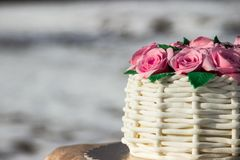 Cake in the form of a basket of roses Stock Image