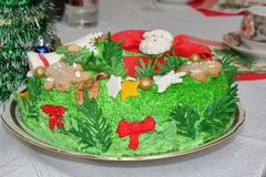Cake in the form of a Christmas wreath. On a table with a white tablecloth stock image