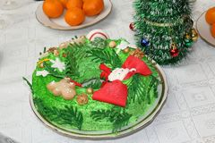 Cake in the form of a Christmas wreath. On a table with a white tablecloth stock images