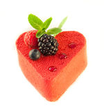 Cake in the form of heart. With a blackberry, a raspberry and mint, a cup of coffee stock photo